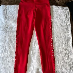 Red workout leggings, see through sides